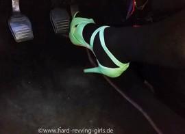 Mandy revs old Fiesta in green High Heels and black tan